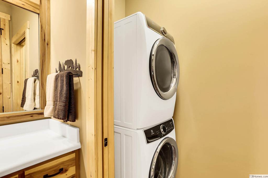 Stackable washer dryer hidden with pocket door