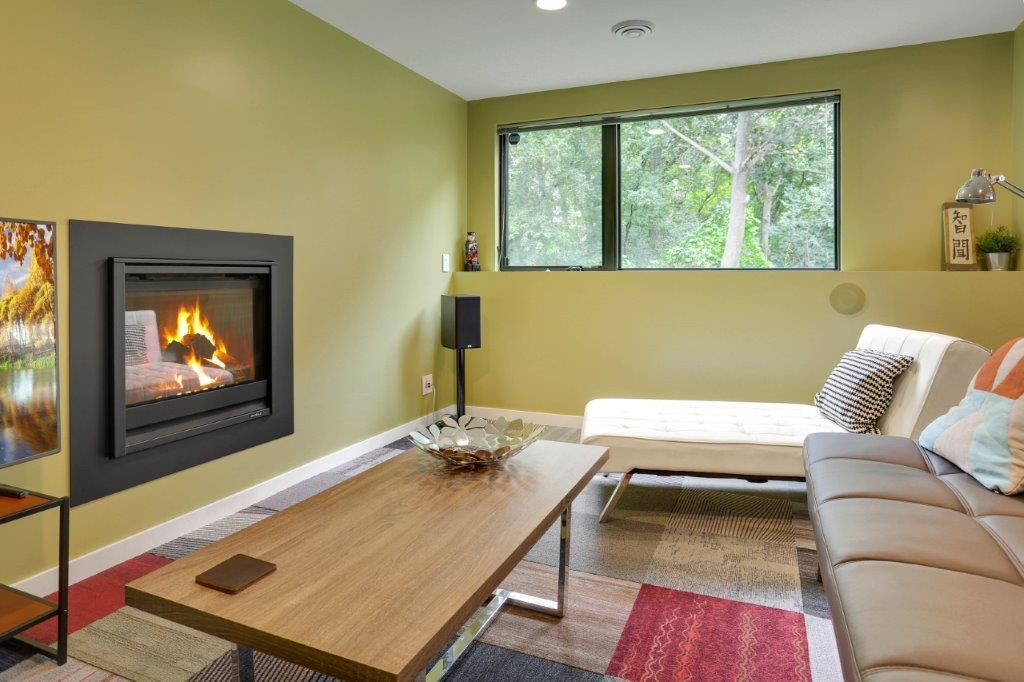 Minneapolis Modern Home Lower Level Rec Room with Fireplace