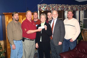 TJB Homes Presents $10,000 to Alexandra House to combat Domestic Violence.