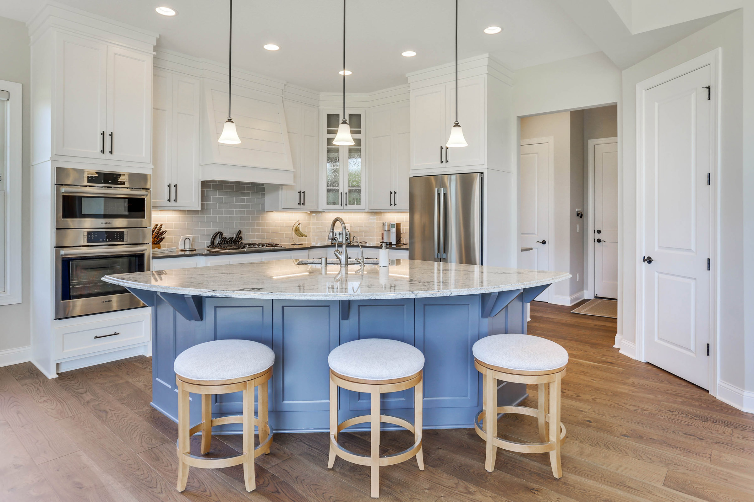 TJB Home Plan #499 White Kitchen with Blue Accent Island