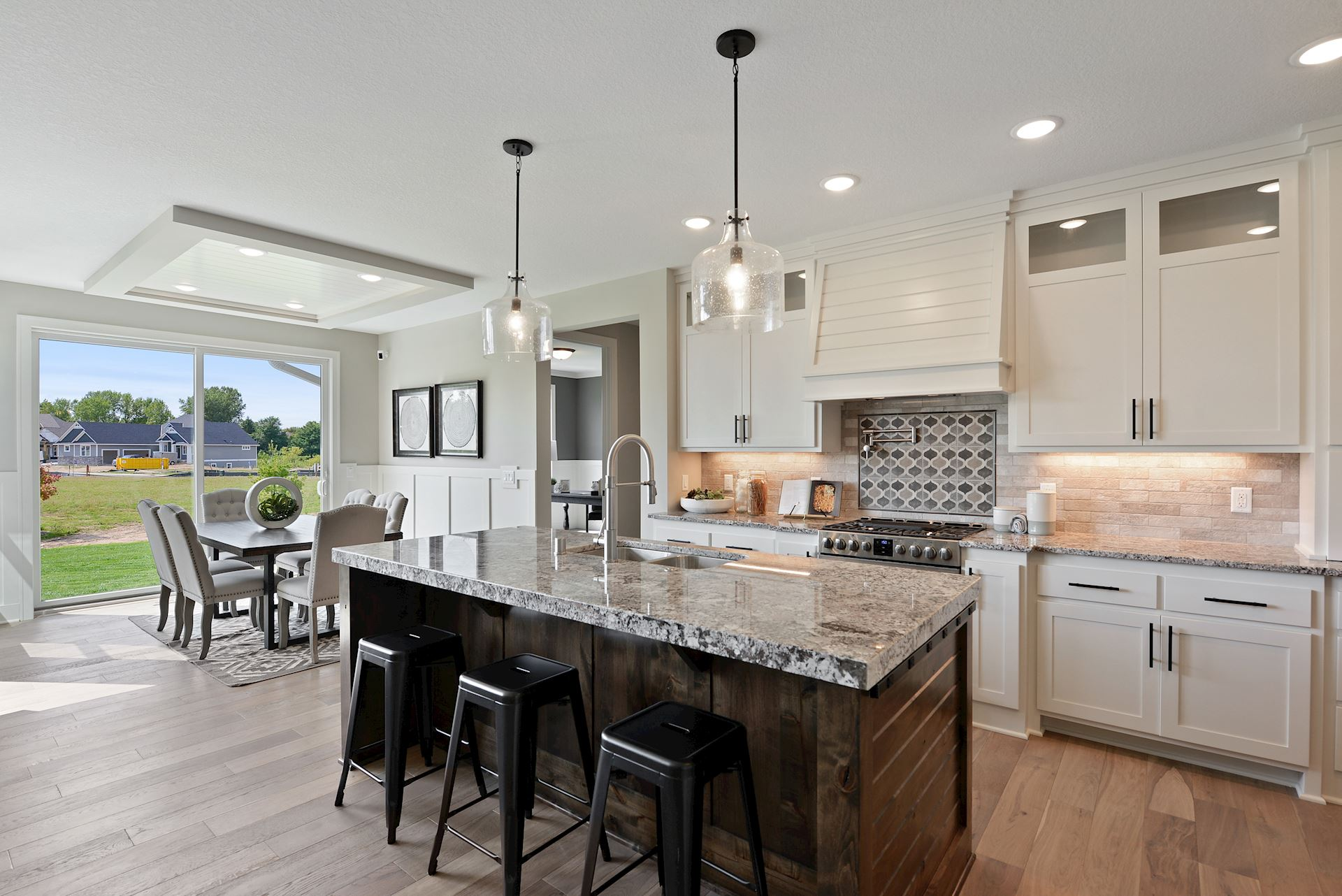 Custom designed kitchen and cabinetry with large island