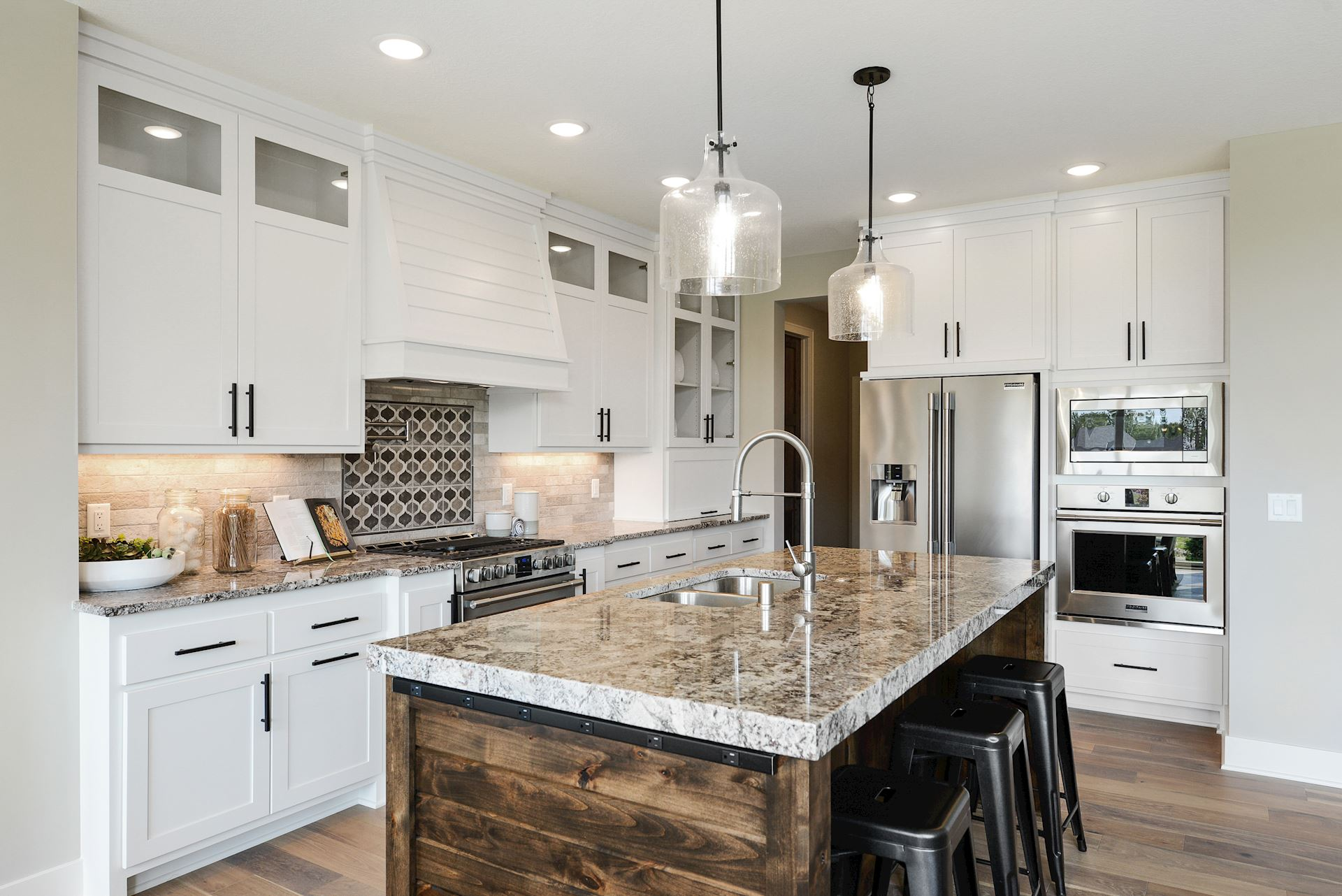 Granite surfaces and hardwood flooring
