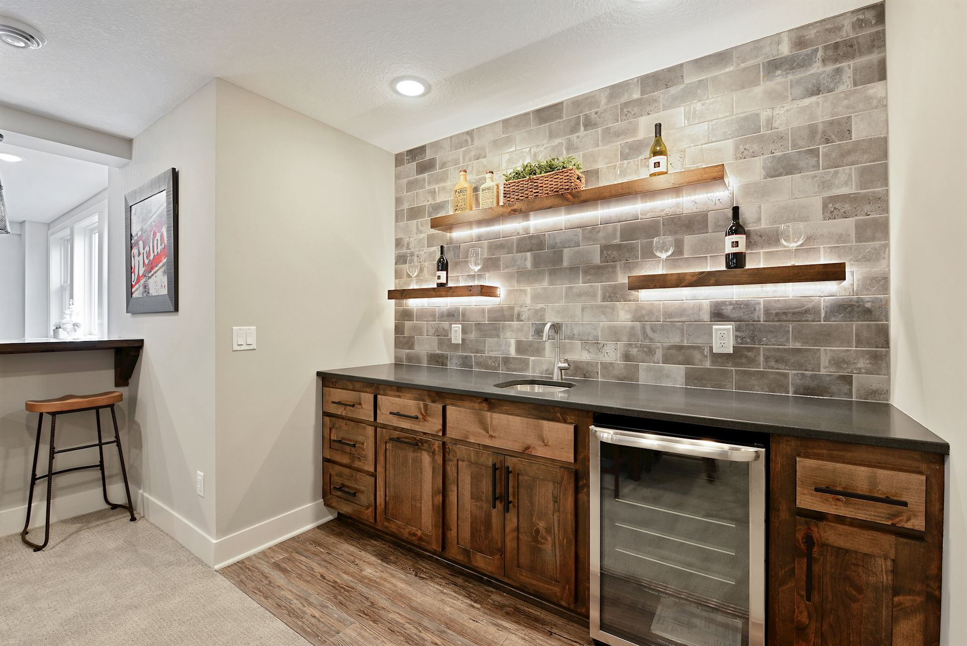 Wet Bar wall with lighted floating shelves